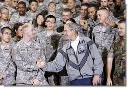 President George W. Bush shakes hands with one of the many personnel he met following his remarks at the U.S. Army Garrison-Yongsan Wednesday, August 6, 2008, in Seoul, South Korea. White House photo by Eric Draper