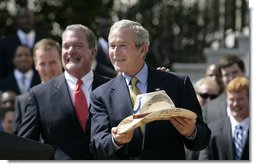 President George W. Bush shows the signed cowboy hat presented to him by Indianapolis Colts team owner and CEO Jim Irsay, left, during the White House ceremony to honor the Super Bowl champions Monday, April 23, 2007. White House photo by Eric Draper