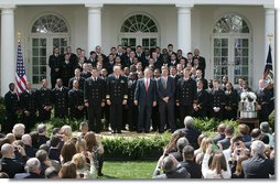 President George W. Bush welcomes members the U. S. Naval Academy football team to the White House, where he presented the Commander-In-Chief trophy to the team in ceremonies in the Rose Garden at the White House, Monday, April 2, 2007. White House photo by Joyce N. Boghosian