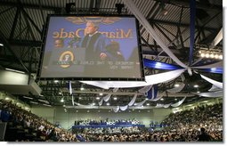 President George W. Bush is shown at the podium in an overhead screen Saturday, April 28, 2007, as he stands onstage at Miami Dade College - Kendall Campus in Miami and delivers the 2007 commencement address. White House photo by Eric Draper