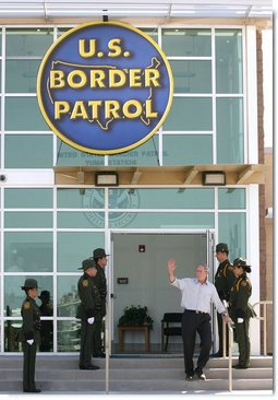 """President George W. Bush waves from the new Yuma Border Patrol Station building Monday, April 9, 2007, during his visit to the Arizona border community to speak on immigration reform. The President told his audience, """"We need to work together to come up with a practical solution to this problem, and I know people in Congress are working hard on this issue.""""  White House photo by Eric Draper"""