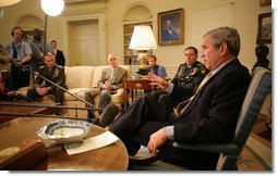 """President George W. Bush delivers a statement on the War in Iraq during a visit Monday, April 23, 2007, by Gen. David Petraeus, Commander of the Multinational Force-Iraq, to the White House. Said the President, """"I will strongly reject an artificial timetable withdrawal and/or Washington politicians trying to tell those who wear the uniform how to do their job."""" With them is Gen. Peter Pace, Chairman of the Joint Chiefs of Staff, left, and Gordon England, Deputy Secretary of Defense.  White House photo by Eric Draper"""