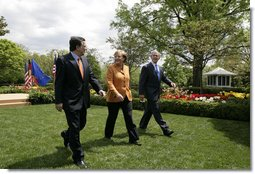 President George W. Bush and European Council President Angela Merkel of Germany, and European Commission President Jose Manuel Barroso of Portugal leave the Rose Garden Monday, April 30, 2007, after their joint press conference. White House photo by Eric Draper