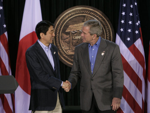 President George W. Bush exchanges handshakes with Prime Minister Shinzo Abe of Japan after their joint press availability Friday, April 27, 2007, at Camp David. White House photo by Joyce Boghosian