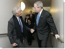 President George W. Bush is greeted by Elie Wiesel, Founding Chairman of the United States Holocaust Memorial Museum, after arriving Wednesday, April 18, 2007, to deliver remarks in commemoration of the Holocaust Days of Remembrance.  White House photo by Eric Draper