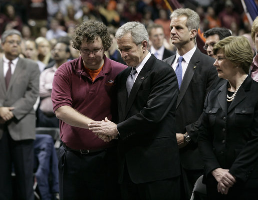President George W. Bush comforts James Tyger, outgoing Student Government president, Tuesday, April 17, 2007, during the Convocation on the campus of Virginia Tech in Blacksburg, Va. The President and Mrs. Laura Bush attended the service honoring students, faculty and staff who died or were injured in Monday's tragic shooting. White House photo by Eric Draper