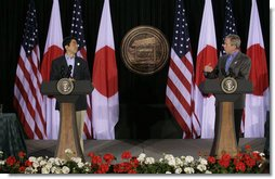 President George W. Bush and Japan's Prime Minister Shinzo Abe hold a joint press availability Friday, April 27, 2007, at Camp David.  White House photo by Joyce N. Boghosian