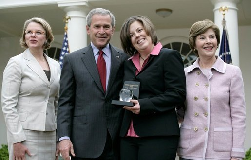 President George W. Bush is joined by Secretary of Education Margaret Spellings and Mrs. Laura Bush as they congratulate the 2007 National Teacher of the Year, Andrea Peterson, during ceremonies Thursday, April 26, 2007, in the Rose Garden. Mrs. Peterson is a music teacher at Monte Cristo Elementary School in Granite Falls, Washington. White House photo by Eric Draper