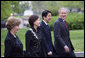 President George W. Bush and Mrs. Laura Bush walk past the press on the North Lawn with Japanese Prime Minister Shinzo Abe and his wife Mrs. Akie Abe Thursday, April 26, 2007, as they arrive for a social dinner at the White House. White House photo by Eric Draper