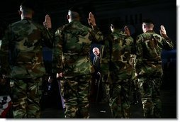Vice President Dick Cheney administers the Ceremonial Oath of Re-enlistment at a rally for the troops at Fort Leavenworth, Kansas, January 6, 2006. Prior to the ceremony the Vice President delivered remarks and commended the troops for their service in Iraq, Afghanistan and in the war on terrorism. Fort Leavenworth holds the title as the oldest Army installation in continuous active service west of the Mississippi.  White House photo by David Bohrer