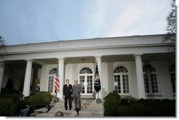 """President George W. Bush and Judge Samuel A. Alito address the media in the Rose Garden Monday, Jan. 9, 2006, after a breakfast meeting in the Private Dining Room. Confirmation hearings for Judge Alito, President Bush's nominee for Associate Justice of the Supreme Court, begin today in Washington, D.C. """"It's very important that members of the Senate conduct a dignified hearing. The Supreme Court is a dignified body; Sam is a dignified person. And my hope, of course, is that the Senate bring dignity to the process and give this man a fair hearing and an up or down vote on the Senate floor,"""" said the President.  White House photo by Kimberlee Hewitt"""