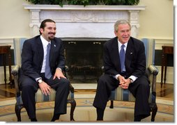 """President George W. Bush meets with Lebanese Parliment member Saad Hariri in the Oval Office Friday, Jan. 27, 2006. """"We've just had a very interesting and important discussion about our mutual desire for Lebanon to be free; free of foreign influence, free of Syrian intimidation, free to chart its own course,"""" said the President.  White House photo by Paul Morse"""