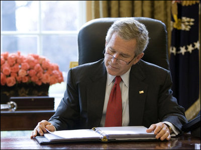 President George W. Bush reads over a draft of his State of the Union speech in the Oval Office Tuesday morning, Jan. 31, 2006, in preparation for the annual address to the nation that evening.