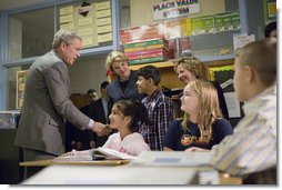 """President George W. Bush and Education Secretary Margaret Spellings visit with students at North Glen Elementary School in Glen Burnie, Md., Monday, Jan. 9, 2006. """"This is a fine school,"""" said the President in his remarks about 'No Child Left Behind' at the school. """"We're here to herald excellence. We're here to praise the law that is working. I'm here to thank the teachers, not only here, but around the state of Maryland and around the country, who are dedicating their lives to providing hope for our future."""" White House photo by Kimberlee Hewitt"""