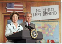 """Laura Bush and President Bush discuss """"No Child Left Behind,"""" at North Glen Elementary School in Glen Burnie, Md., Monday, Jan. 9, 2006. """"Interestingly enough, in 2003, 45 percent of the African American students in this school rated proficient in reading; in 2005, 84 percent are proficient. In other words, this is a school that believes every child can learn. Not just certain children, every child,"""" said the President. White House photo by Kimberlee Hewitt"""