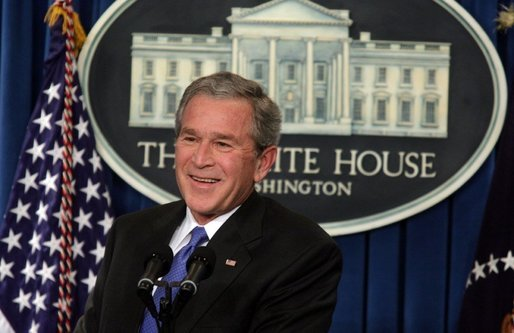President George W. Bush smiles as he listens to reporter's question Thursday, Jan. 26, 2006, during a press conference at the White House that covered several topics including economy, the upcoming election year and fiscal policy. White House photo by Kimberlee Hewitt