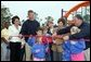Laura Bush attends a ribbon cutting ceremony with football star Brett Favre and his wife, Deanna, left, Secretary Margaret Spelling, center, Dan Vogel, Associate Director, USA Fredom Corps, right, and student of Hancock North Central Elementary Shool at the Kaboom Playground, built at the Hancock North Central Elementary School in Kiln, Ms., Wednesday, Jan. 26, 2006, during a visit to the area ravaged by Hurricane Katrina. White House photo by Shealah Craighead