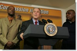"""President George W. Bush stands next to graduates Adolphus Mosely, left, and Thomas Boyd, as he delivers remarks after visit the faith-based Jericho Program Tuesday, Jan. 29, 2008, in Baltimore. Said the President, """"I've come to look firsthand at the Jericho Program, which is helping former prisoners make a successful transition back to society. There's no more important goal than to help good souls become -- come back to our society as productive citizens. I'm honored to have been with those who have worked hard to deal with their circumstances in such a way that they become productive citizens. I'm standing next to two such men, and I met probably seven others downstairs."""" White House photo by Joyce N. Boghosian"""