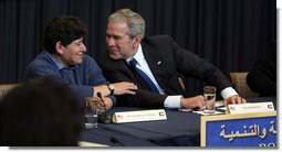President George W. Bush leans toward Dr. Rasha Al Sabah, Kuwait's Undersecretary for Higher Education, during a roundtable discussion in Kuwait City, Saturday, Jan. 12, 2008, on democracy and development with Kuwaiti women. White House photo by Eric Draper