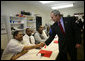 President George W. Bush shakes hands with a participant in the Jericho Program while visiting a classroom Tuesday, Jan. 29, 2008, in Baltimore. Serving men 18 years and older who have been released from prison within the last 6 months and who have never been convicted of a violent offense, the program helps them rebuild their lives while fostering a new sense of self-worth and a commitment to productive, healthy lifestyles. White House photo by Joyce N. Boghosian