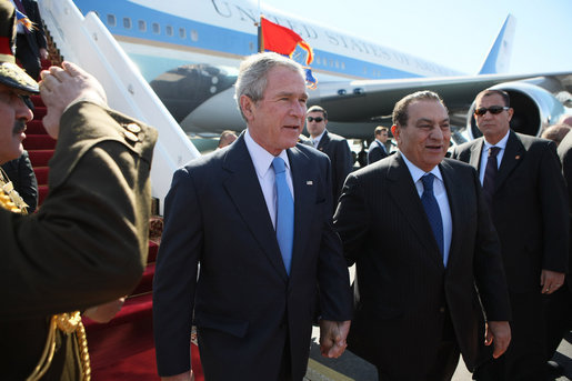 President George W. Bush walks with Egyptian President Hosni Mubarak after arriving at Sham El Sheikh International Airport, Wednesday, Jan. 16, 2008. White House photo by Eric Draper