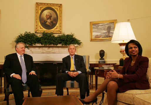 """President George W. Bush and Secretary of State Condoleezza Rice sit in the Oval Office with Rich Williamson, Special Envoy for Sudan Thursday, Jan. 17, 2008, to discuss the continuing commitment by the United States to help the citizens of Sudan. Said the President, """". One of the reasons we care about the suffering in Sudan is because we care about the human condition all across the face of the earth. And we fully understand that when people suffer, it is in our interest to help."""" White House photo by Joyce N. Boghosian"""
