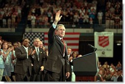 """President George W. Bush waves during his visit to the Knoxville Civic Center in Knoxville, Tenn., Monday, April 8. Listing several specific ways Americans can volunteer, the president spoke about the value and need of community service. """"And so for those of you out there who are interested in participating, I want you to call up this number, 1-877-USA-CORPS, or to dial up on the Internet, www.citizencorps.gov. This is a way where you can help America,"""" said President Bush. White House photo by Paul Morse."""