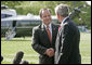 """White House Press Secretary Scott McClellan and President Bush announce that Mr. McClellan is resigning his position on the South Lawn Wednesday, April 19, 2006. """"One of these days he and I are going to be rocking on chairs in Texas, talking about the good old days and his time as the Press Secretary,"""" said the President. """"And I can assure you I will feel the same way then that I feel now, that I can say to Scott, job well done."""" White House photo by Eric Draper"""