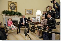 President George W. Bush addresses the press during a meeting with a family of North Korean defectors and family members of Japanese citizens who were abducted by the North Korean government in the Oval Office Friday, April 28, 2006. Kim Han-Mee, the daughter of North Korean defectors, sat next to the President. White House photo by Paul Morse