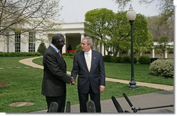 """After meeting in the Oval Office,President George W. Bush and President John Kufuor of Ghana shake hands during a joint statement to the press on the South Lawn Wednesday, April 12, 2006. """"We just had a wonderful discussion about our bilateral relations, and a great discussion about the world. I really enjoy talking to a man of vision and strength and character. President Kufuor has done a fantastic job for Ghana,"""" said President Bush. """"He's told the people of his country he'd bring honesty to government, and he has. He told the people of his country that he would work to create a stable economic platform for -- and he has done that, as well. And he's a man of peace. He cares deeply about peace in the region.""""  White House photo by Kimberlee Hewitt"""