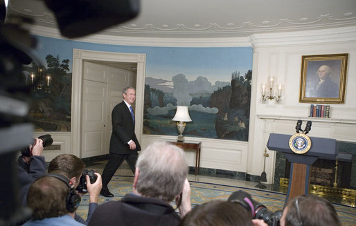 """President George W. Bush walks into the Diplomatic Reception Room where he addressed the press Friday, April 7, 2006. """"Good morning, This morning's economic report shows that America's growing economy added 211,000 jobs in the month of March,"""" said the President. """"The American economy has now added jobs for 31 months in a row, created more than 5.1 million new jobs for American workers. The unemployment rate is now down to 4.7 percent -- that's below the average rate of the 1960s, 1970s, 1980s and 1990s."""" White House photo by Kimberlee Hewitt"""