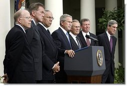 Standing with members of his national security team, President George W. Bush discusses America's intelligence reforms in the Rose Garden Monday, Aug. 2, 2004.   White House photo by Paul Morse