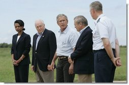 Standing with his national defense team, President George W. Bush talks with the press at Prairie Chapel Ranch in Crawford, Texas, Monday, Aug. 23, 2004. Pictured, from left, are: Dr. Condoleezza Rice, Vice President Dick Cheney, Secretary of Defense Donald Rumsfeld and Chairman of the Joint Chiefs of Staff General Richard Meyers.  White House photo by Paul Morse