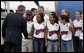 President George W. bush greets the Midway, Texas Little League Team, the 2004 Little League Softball World Series Champions before departing from Texas State Technical College AIrport in Waco, Texas on Thursday August 26, 2004. White House photo by Paul Morse.