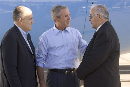 President George W. Bush and former New York City mayor Rudi Giuliani talk with Freedom Corps greeter Frank Ontiveros in Las Cruces, New Mexico on Thursday August 26, 2004. White House photo by Paul Morse.