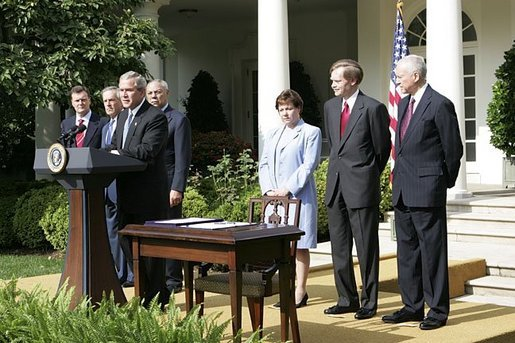"""President George W. Bush delivers remarks during the signing ceremony of H.R. 4759, The United States-Australia Free Trade Agreement Implementation Act in the Rose Garden Tuesday, Aug. 3, 2004. """"It expands our security and political alliance by creating a true economic partnership. It will create jobs and opportunities,"""" said President Bush."""