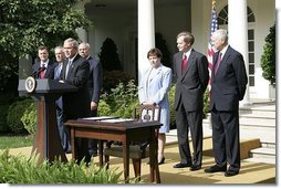 "President George W. Bush delivers remarks during the signing ceremony of H.R. 4759, The United States-Australia Free Trade Agreement Implementation Act in the Rose Garden Tuesday, Aug. 3, 2004. ""It expands our security and political alliance by creating a true economic partnership. It will create jobs and opportunities,"" said President Bush."