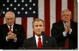 """President George W. Bush delivers his State of the Union Address to the nation and a joint session of Congress in the House Chamber of the U.S. Capitol Tuesday, Jan. 20, 2004. """"We have not come all this way – through tragedy, and trial, and war – only to falter and leave our work unfinished. Americans are rising to the tasks of history, and they expect the same of us,"""" said President Bush in his remarks.  White House photo by Eric Draper"""