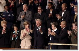 """Mrs. Bush applauds her special guest, Dr. Adnan Pachachi, President of the Iraqi Governing Council, during President Bush's State of the Union Address at the U.S. Capitol Tuesday, Jan. 20, 2004. """"Sir, America stands with you and the Iraqi people as you build a free and peaceful nation,"""" said the President in his acknowledgement of Dr. Pachachi.  White House photo by Paul Morse"""