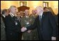 Photo.Vice President Dick Cheney thanks Italian military members who served in Afghanistan and Iraq after addressing Italian politicians and young professionals at the Palazzo Minerva in Rome, Italy Jan. 26, 2004. About 3,000 Italian troops and law enforcement officers were sent to Iraq to help rebuild the nation after the fall of Baghdad on April 9, 2003. White House photo by David Bohrer