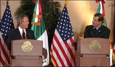 """President George W. Bush and President Vicente Fox of Mexico participate in a press conference Jan. 12, 2004. """"The bonds of friendship and shared values between our two nations are strong,"""" said President Bush. """"We have worked together to overcome many mutual challenges, and that work is yielding results."""" White House photo by Paul Morse"""