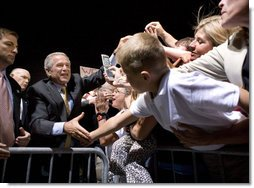 """President George W. Bush greets the crowd during an airport welcome at the Utah Air National Guard in Salt Lake City, Utah, Wednesday, Aug. 30, 2006. Nearly 2000 local residents and base personnel turned out to welcome the President. """"For those of you with loved ones in the United States military, I thank you from the bottom of my heart, said President Bush in his remarks. """"I can't tell you how proud I am to be the Commander-in-Chief of such a fantastic group of young men and women."""" White House photo by Eric Draper"""