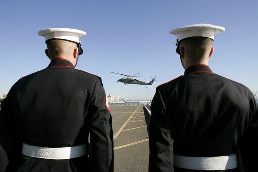 A Marine helicopter carries White House Staff to a New York City landing zone ahead of President George W. Bush, Monday, Sept. 20, 2004. White House photo by Eric Draper