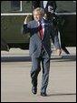 President George W. Bush salutes as he departs Waco, Texas, Monday, Sept. 27, 2004. White House photo by Eric Draper.