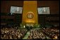 """President George W. Bush addresses the United Nations Headquarters in New York City Tuesday, Sept. 21, 2004. """"Defending our ideals is vital, but it is not enough. Our broader mission as U.N. members is to apply these ideals to the great issues of our time,"""" said the President. """"Our wider goal is to promote hope and progress as the alternatives to hatred and violence. Our great purpose is to build a better world beyond the war on terror."""" White House photo by Paul Morse."""