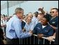 Prior to boarding Air Force One, President George W. Bush greets military personnel at Willow Grove Naval Air Station, Pa., Thursday, Sept. 9, 2004. White House photo by Tina Hager.
