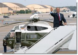 President George W. Bush boards Air Force One at Andrews Air Force Base en route to Colmar, Pa., Thursday, Sept. 9, 2004.   White House photo by Tina Hager
