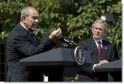"""Iraqi interim Prime Minister Ayad Allawi discussed his country's counter-terrorism plan during a press conference in the Rose Garden Thursday, Sept. 23, 2004. """"The Iraqi government now commands almost 100,000 trained and combat-ready Iraqis, including police, national guard and army. The government have accelerated the development of Iraqi special forces and established a counter-terrorist strike force to address the specific problems caused by the insurgency,"""" said the Prime Minister.  White House photo by Eric Draper"""