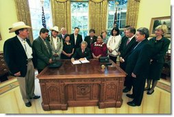 President George W. Bush signs an Executive Memorandum on Tribal Sovereignty and Consultation in honor of the opening of the National Museum of the American Indian, Thursday, Sept. 23, in the Oval Office.  White House photo by Tina Hager