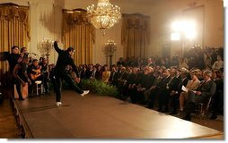 President George W. Bush and Laura Bush watch the performance of Joaquin Cortes as he dances to a quintet of Flamenco musicians during a Hispanic Heritage Month celebration in the East Room of the White House Wednesday, Sept. 15, 2004.  White House photo by Joyce Naltchayan